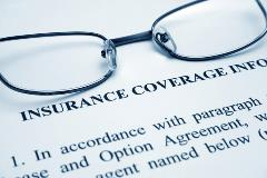 eyeglasses on insurance paper